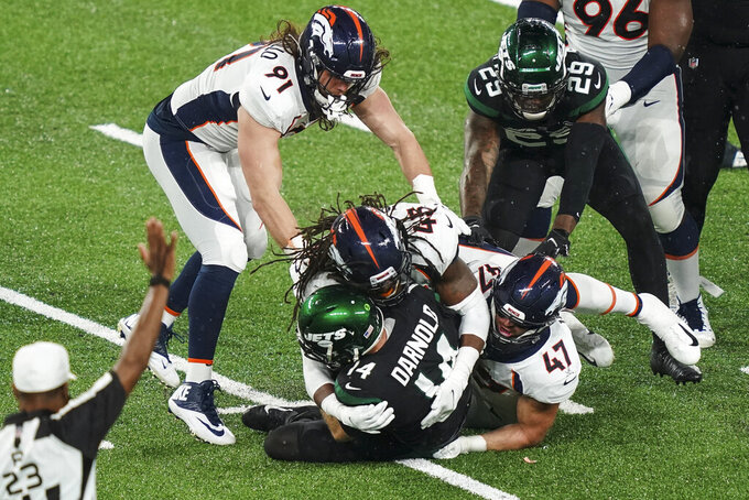 Denver Broncos' A.J. Johnson (45) and Josey Jewell (47) sack New York Jets quarterback Sam Darnold (14) during the second half of an NFL football game Thursday, Oct. 1, 2020, in East Rutherford, N.J. (AP Photo/John Minchillo)