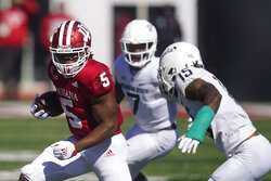 Indiana's Stephen Carr (5) is tackled by Michigan State's Angelo Grose (15) during the first half of an NCAA college football game, Saturday, Oct. 16, 2021, in Bloomington, Ind. (AP Photo/Darron Cummings)