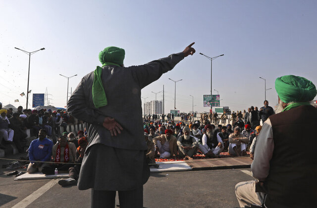 Protesting farmers camp on a highway at the Delhi- Uttar Pradesh border, outskirts of New Delhi, India, Friday, Dec. 18, 2020. India's prime minister says his government is willing to address the concerns of tens of thousands of farmers who are blocking key highways in a protest against new agricultural reform laws, but is rejecting their demand that the legislation be repealed. (AP Photo/Manish Swarup)