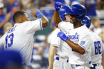 Kansas City Royals' Salvador Perez (13) congratulates Michael A. Taylor, right, after hitting a home run during the fifth inning of a baseball game against the Seattle Mariners at Kauffman Stadium in Kansas City, Mo., Saturday, Sept. 18, 2021. (AP Photo/Colin E. Braley)