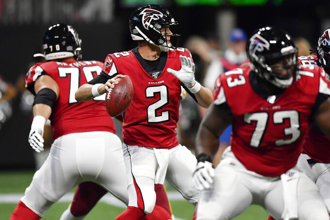 Atlanta Falcons quarterback Matt Ryan (2) works in the pocket against the Washington Redskins during the first half an NFL preseason football game, Thursday, Aug. 22, 2019, in Atlanta. (AP Photo/Mike Stewart)