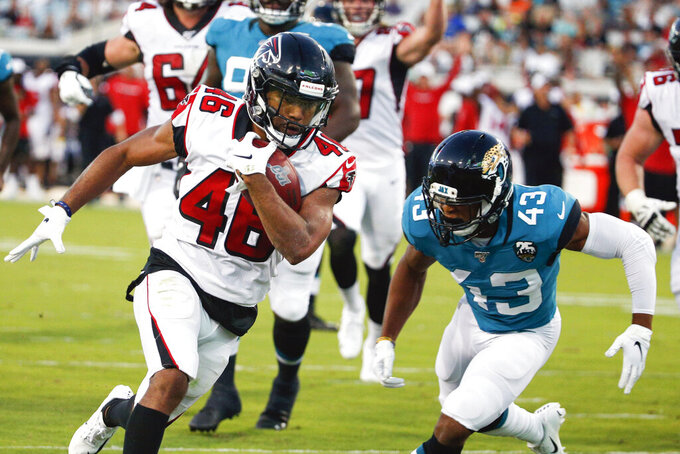 Atlanta Falcons running back Tony Brooks-James, left, runs past Jacksonville Jaguars defensive back Picasso Nelson (43) for a 15-yard touchdown run during the first half of an NFL preseason football game, Thursday, Aug. 29, 2019, in Jacksonville, Fla. (AP Photo/Stephen B. Morton)