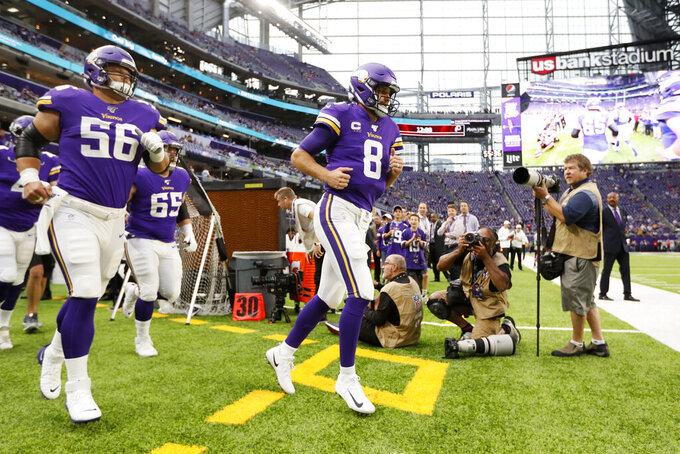 Minnesota Vikings quarterback Kirk Cousins (8) runs onto the field before an NFL football game against the Atlanta Falcons, Sunday, Sept. 8, 2019, in Minneapolis. (AP Photo/Charlie Neibergall)