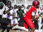 UNLV wide receiver Darren Woods Jr. (10) makes a catch and runs for a touchdown past Hawaii defensive backs Rojesterman Farris II (4) and Eugene Ford (8) in the first quarter of an NCAA college football game Saturday, Nov. 16, 2019, in Las Vegas. (Benjamin Hager/Las Vegas Review-Journal via AP)