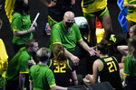 Oregon head coach Kelly Graves, center, talks to his team during a timeout in the first half of a college basketball game against Georgia in the second round of the women's NCAA tournament at the Alamodome in San Antonio, Wednesday, March 24, 2021. (AP Photo/Eric Gay)