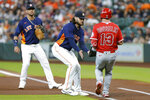 Houston Astros starting pitcher Lance McCullers Jr., middle, makes the tag on Los Angeles Angels left fielder Phil Gosselin (13) on his infield grounder as first baseman Yuli Gurriel, left, looks on during the second inning of a baseball game Sunday, Sept. 12, 2021, in Houston. (AP Photo/Michael Wyke)