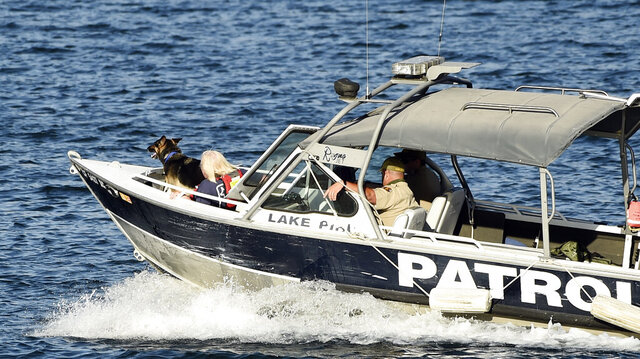 A patrol boat with a search and rescue dog heads out on Lake Piru Reservoir, Thursday, July 9, 2020, in Ventura, Calif. Authorities said Thursday that they believe Rivera drowned in a Southern California lake but they are continuing the search for her a day after her 4-year-old son was found alone in a rented boat. (AP Photo/Chris Pizzello)