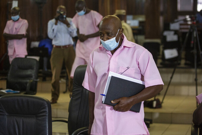 """FILE - In this Friday, Feb. 26, 2021 file photo, Paul Rusesabagina, who inspired the film """"Hotel Rwanda"""" and is credited with saving more than 1,000 people by sheltering them at the hotel he managed during the genocide, attends a court hearing in Kigali, Rwanda. A court in Rwanda said Monday, Sept. 20, 2021 that Rusesabagina, who boycotted the announcement after declaring he didn't expect justice in a trial he called a """"sham"""", is guilty of terror-related offenses. (AP Photo/Muhizi Olivier, File)"""