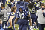 Seattle Seahawks defensive tackle Poona Ford turns away from the field as he stands at the bench late in the second half of an NFL wild-card playoff football game against the Los Angeles Rams, Saturday, Jan. 9, 2021, in Seattle. (AP Photo/Ted S. Warren)