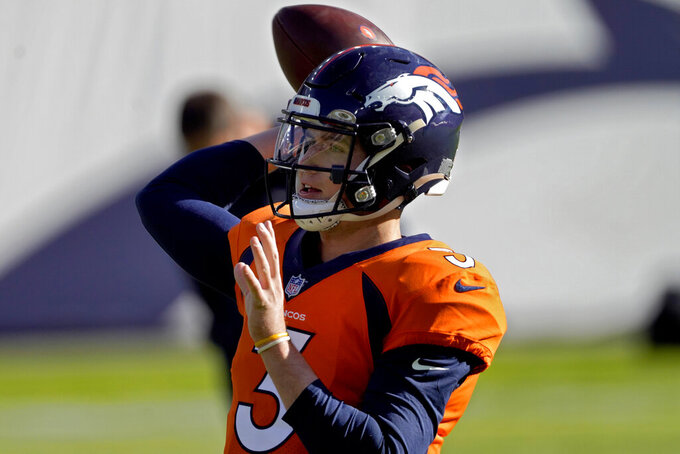Denver Broncos quarterback Drew Lock (3) warms up prior to an NFL football game against the Miami Dolphins, Sunday, Nov. 22, 2020, in Denver. (AP Photo/Jack Dempsey)