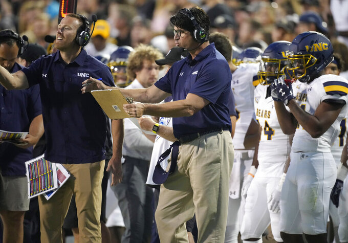 Northern Colorado head coach Ed McCaffrey, center, directs his team against Colorado in the first half of an NCAA college football game Friday, Sept. 3, 2021, in Boulder, Colo. (AP Photo/David Zalubowski)