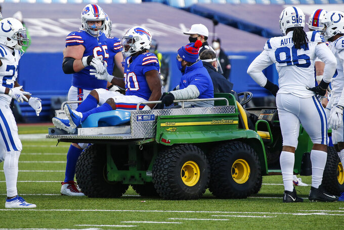 Buffalo Bills running back Zack Moss (20) is carted off the field after being injured during the second half of an NFL wild-card playoff football game against the Indianapolis Colts Saturday, Jan. 9, 2021, in Orchard Park, N.Y. (AP Photo/Jeffrey T. Barnes)