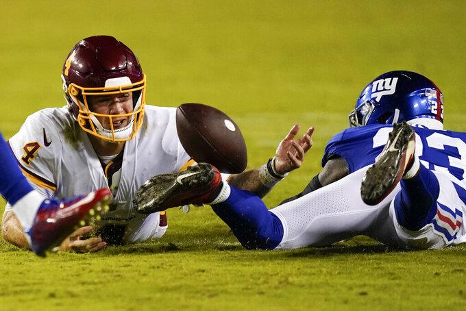 Washington Football Team quarterback Taylor Heinicke (4) looses the ball against New York Giants cornerback Logan Ryan (23) during the second half of an NFL football game, Thursday, Sept. 16, 2021, in Landover, Md. (AP Photo/Alex Brandon)