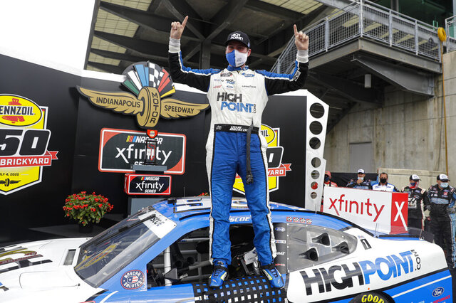 NASCAR Xfinity Series driver Chase Briscoe celebrates winning the NASCAR Xfinity Series auto race at Indianapolis Motor Speedway in Indianapolis, Saturday, July 4, 2020. (AP Photo/Darron Cummings)