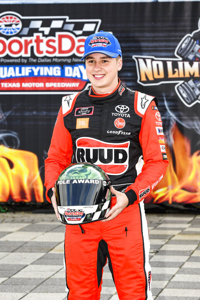 Driver Christopher Bell poses in victory lane after winning the pole position in qualifying for a NASCAR auto race at Texas Motor Speedway, Saturday, March 30, 2019, in Fort Worth, Texas. (AP Photo/Larry Papke)