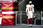 Washington Football Team quarterback Alex Smith (11) walks to the field for the start of the second half of an NFL football game against the San Francisco 49ers, Sunday, Dec. 13, 2020, in Glendale, Ariz. Washington Football Team quarterback Dwayne Haskins replaced Smith for the start of the second half. (AP Photo/Rick Scuteri)