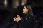 Vanderbilt coach Stephanie White communicates with players during the first half of an NCAA college basketball game against South Carolina Monday, Feb. 17, 2020, in Columbia, S.C. (AP Photo/Sean Rayford)
