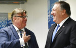 U.S. Secretary of State Mike Pompeo, right, chats with Finland's Foreign Minister Timo Soini ahead of a bilateral meeting at the Lappi Areena in Rovaniemi, Finland Tuesday, May 7, 2019. (Mandel Ngan/Pool Photo via AP)
