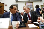 FILE - In this May 2, 2017, file photo United Airlines CEO Oscar Munoz, left, talks with United Airlines President Scott Kirby on Capitol Hill in Washington prior to testifying before the House Transportation Committee oversight hearing. United Airlines CEO Munoz is stepping down from his post and will become executive chairman. The airline said Thursday, Dec. 5, 2019, that Kirby will be its new CEO. (AP Photo/Pablo Martinez Monsivais, File)