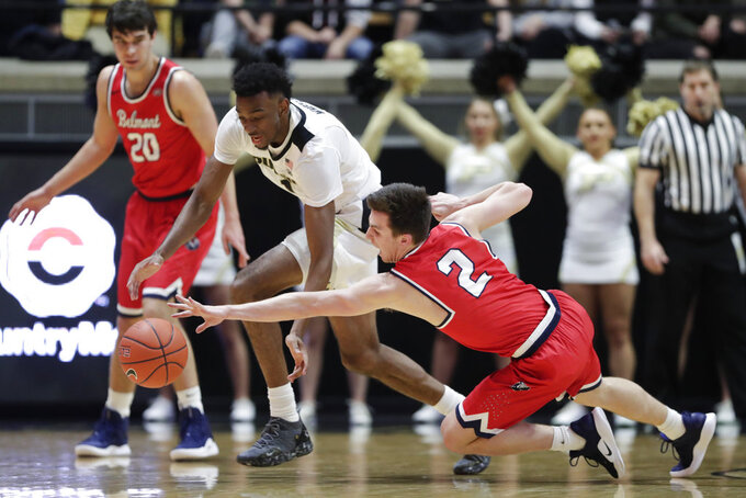 Belmont guard Grayson Murphy (2) Knicks the ball away from Purdue forward Aaron Wheeler (1) during the first half of an NCAA college basketball game in West Lafayette, Ind., Saturday, Dec. 29, 2018. (AP Photo/Michael Conroy)