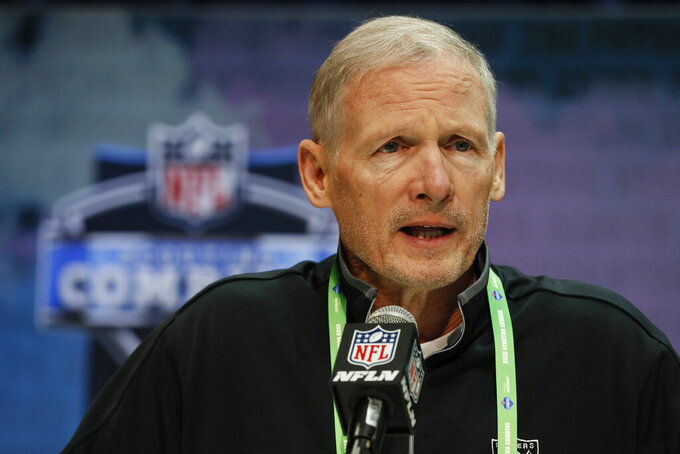 FILE - Las Vegas Raiders general manager Mike Mayock speaks during a press conference at the NFL football scouting combine in Indianapolis, in this Tuesday, Feb. 25, 2020, file photo. The Las Vegas Raiders spent the free agency period dismantling their offensive line and mostly ignoring the secondary. Now heading into the NFL draft, those are the two spots that appear to be the most urgent needs for the Raiders to fill starting with pick No. 17 in the first round. (AP Photo/Charlie Neibergall, File)