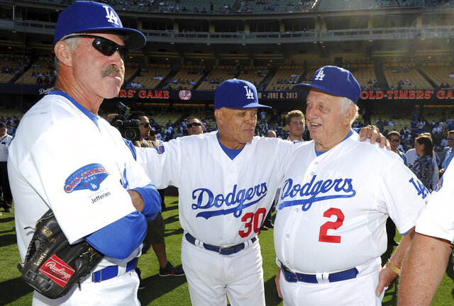 Hall of Fame and former Los Angeles Dodgers manager Tommy Lasorda passed away at the age of 93. Former Los Angeles Dodgers manager Tommy Lasorda, right, with Maury Wills (30) and Bill Buckner (22) during the Old-Timers game prior to a baseball game between the Atlanta Braves and the Los Angeles Dodgers on Saturday, June 8, 2013 in Los Angeles. (Keith Birmingham/The Orange County Register via AP)