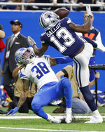 Dallas Cowboys wide receiver Michael Gallup (13) bobbles the ball during interference from Detroit Lions defensive back Mike Ford (38) during the first half of an NFL football game, Sunday, Nov. 17, 2019, in Detroit. (AP Photo/Rick Osentoski)