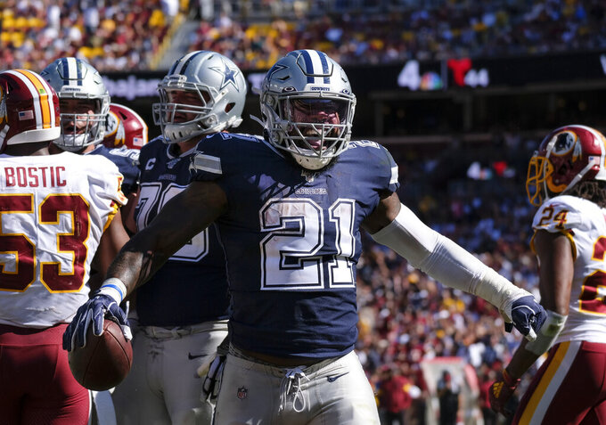 Dallas Cowboys running back Ezekiel Elliott (21) celebrates scoring in the second half of an NFL football game against the Washington Redskins, Sunday, Sept. 15, 2019, in Landover, Md. (AP Photo/Mark Tenally)