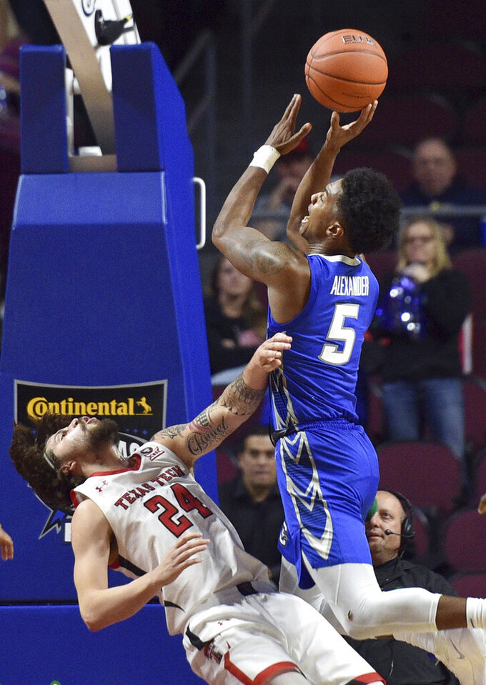 Creighton guard Ty-Shon Alexander (5) shoots over Texas Tech guard Avery Benson during the second half of an NCAA college basketball game Friday, Nov. 29, 2019, in Las Vegas. (AP Photo/David Becker)