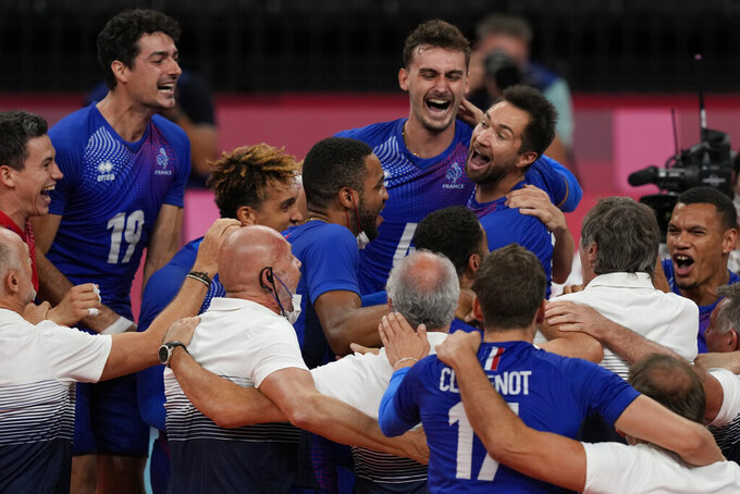 Team France celebrates their 3-0 victory over Argentina, at the end of a men's volleyball semifinal match, at the 2020 Summer Olympics, Thursday, Aug. 5, 2021, in Tokyo, Japan. (AP Photo/Frank Augstein)