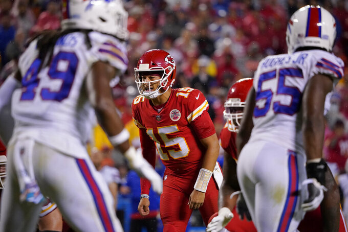 Kansas City Chiefs quarterback Patrick Mahomes calls out on the line of scrimmage during the second half of an NFL football game against the Buffalo Bills Sunday, Oct. 10, 2021, in Kansas City, Mo. (AP Photo/Ed Zurga)