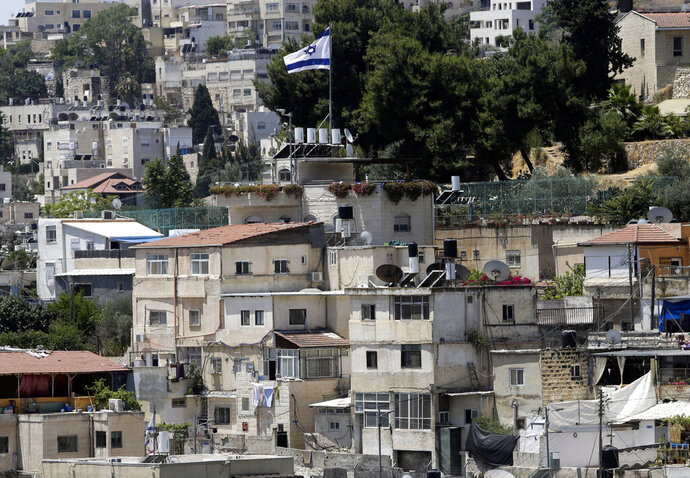 An Israeli flag flies over a Jewish owned house in a Palestinian neighborhood of Silwan in east Jerusalem, Wednesday, July 1, 2020. Israeli leaders paint Jerusalem as a model of coexistence, the