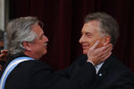 Argentina's new President Alberto Fernandez, left, greets outgoing president Mauricio Macri after receiving from him the presidential sash at the Congress in Buenos Aires, Argentina, Tuesday, Dec. 10, 2019. (AP Photo/Natacha Pisarenko)