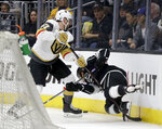 Vegas Golden Knights defenseman Shea Theodore, left, and Los Angeles Kings center Tyler Toffoli battles for the puck during the second period of Game 3 of an NHL hockey first-round playoff series in Los Angeles, Sunday, April 15, 2018. (AP Photo/Chris Carlson)