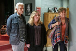 """This image released by Netflix shows Michael Douglas, from left, Sarah Baker and Kathleen Turner in a scene from the third and final season of """"The Kominsky Method."""" (Erik Voake/Netflix via AP)"""