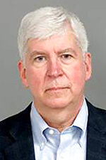 This Jan. 14, 2021 photo provided by the Genesee County Sheriff's Office in Flint, Mich., shows former Michigan Gov. Rick Snyder. Snyder was charged with two misdemeanor counts willful neglect of duty Jan. 14, 2021 in connection with the Flint water crisis in Flint, Mich. (Genesee County Sheriff's Office via AP)