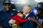 From left to right, Dallas Cowboys first-round draft pick linebacker Micah Parsons,  his son Malcolm, 2, Dallas Cowboys owner Jerry Jones and Shatra Parsons pose for photos after a press conference at the Dallas Cowboys headquarters, Friday, April 30, 2021, in Frisco, Texas. (AP Photo/Brandon Wade)