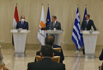 Cyprus President Nicos Anastasiades, center, Greece's Prime minister Kyriakos Mitsotakis, right, and Egypt's President Abdel-Fattah el-Sissi talk to the media during a press conference after their meeting at the presidential palace in capital Nicosia, Cyprus, on Wednesday, Oct. 21, 2020. The leaders of Cyprus, Egypt and Greece meet in the Cypriot capital for talks on forging closer ties and boosting cooperation on issues including energy following the discovery of gas deposits in the east Mediterranean. (Iakovos Hatzistavrou Pool via AP)