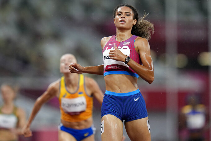 Sydney Mclaughlin, of the United States, competes in a semifinal of the women's 400-meter hurdles at the 2020 Summer Olympics, Monday, Aug. 2, 2021, in Tokyo. (AP Photo/Petr David Josek)