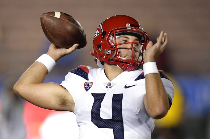 Arizona quarterback Rhett Rodriguez passes during the first half of an NCAA college football game against UCLA, Saturday, Oct. 20, 2018, in Pasadena, Calif. (AP Photo/Mark J. Terrill)
