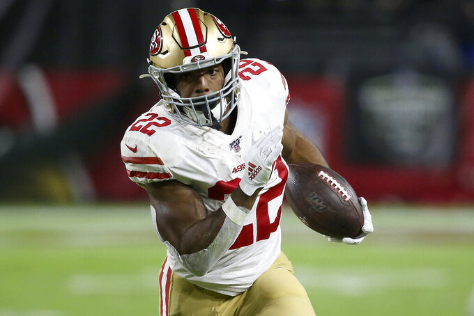 FILE - In this Oct. 31, 2019, file photo, San Francisco 49ers running back Matt Breida (22) carries the ball against the Arizona Cardinals during the first half of an NFL football game in Glendale, Ariz. Breida has been traded to the Miami Dolphins by the San Francisco 49ers for a fifth-round draft pick on Saturday, April 25, 2020. (AP Photo/Ross D. Franklin, FIle)