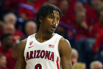 Arizona guard Dylan Smith returns to the game against Washington after having broken his nose during the first half of an NCAA college basketball game Saturday, March 7, 2020, in Tucson, Ariz. (AP Photo/Rick Scuteri)