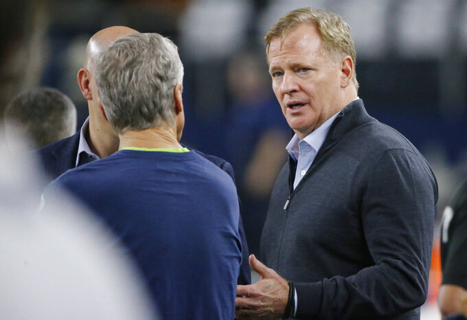 NFL Commissioner Roger Goodell speaks with Seattle Seahawks head coach Pete Carroll before a NFC wild-card NFL football game between the Dallas Cowboys and the Seattle Seahawks in Arlington, Texas, Saturday, Jan. 5, 2019. (AP Photo/Roger Steinman)