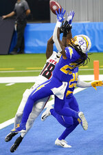 Los Angeles Chargers strong safety Rayshawn Jenkins (23) makes an interception in the end zone behind Atlanta Falcons wide receiver Calvin Ridley (18) during the second half of an NFL football game Sunday, Dec. 13, 2020, in Inglewood, Calif. (AP Photo/Jae C. Hong )