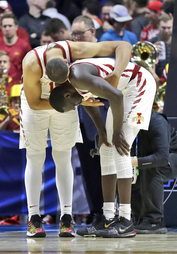 Iowa State's Talen Horton-Tucker, left, consoles teammate Marial Shayok after losing to Ohio State in a first round men's college basketball game in the NCAA Tournament Friday, March 22, 2019, in Tulsa, Okla. Ohio State won 62-59. (AP Photo/Jeff Roberson)
