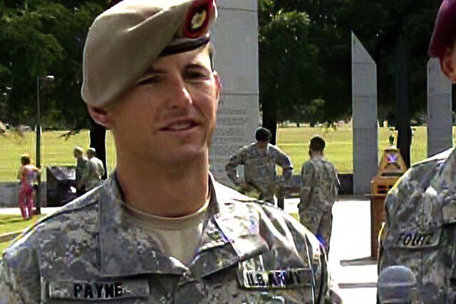 In this image from video provided by the U.S. Army, then-Sgt. 1st Class Thomas Payne is interviewed as a winner of the 2012 Best Ranger competition at Fort Benning, Ga., on April 16, 2012. Payne will receive the Medal of Honor, the U.S. military's highest honor for valor in combat, for actions during a daring 2015 raid in Iraq that rescued about 70 hostages who were set to be executed by ISIS militants, The Associated Press has learned. Sgt. Maj. Payne will receive the honor in a White House ceremony on the 19th anniversary of the Sept. 11, 2001, terrorist attacks. (Lori Egan/U.S., Army via AP)