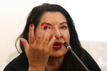 Performance artist Marina Abramovic speaks during the press conference for the art exhibition