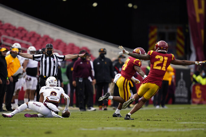 Southern California safety Isaiah Pola-Mao (21) and safety Max Williams (4) celebrate after an incomplete pass intended for Arizona State wide receiver LV Bunkley-Shelton (2) during the second half of an NCAA college football game Saturday, Nov. 7, 2020, in Los Angeles. (AP Photo/Ashley Landis)