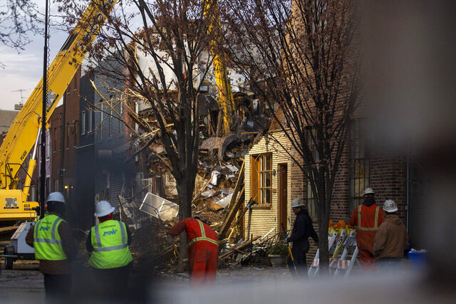 Construction workers start taking down one of the buildings next to the few homes that were caught in the explosion on Saturday, Dec. 21, 2019, in Philadelphia. Authorities have recovered the bodies of two victims following an explosion and fire on Thursday that destroyed several row homes in south Philadelphia. (Tyger Williams/The Philadelphia Inquirer via AP)