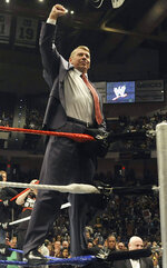 FILE - In this Oct. 30, 2010, file photo, World Wrestling Entertainment chairman Vince McMahon raises his arm in the air to the audience during a fan appreciation event in Hartford, Conn. A federal appeals court on Wednesday, Sept. 9, 2020, dismissed a lawsuit filed by 50 former professional wrestlers, who claimed WWE failed to protect them from repeated head trauma including concussions that led to long-term brain damage. (AP Photo/Jessica Hill, File)